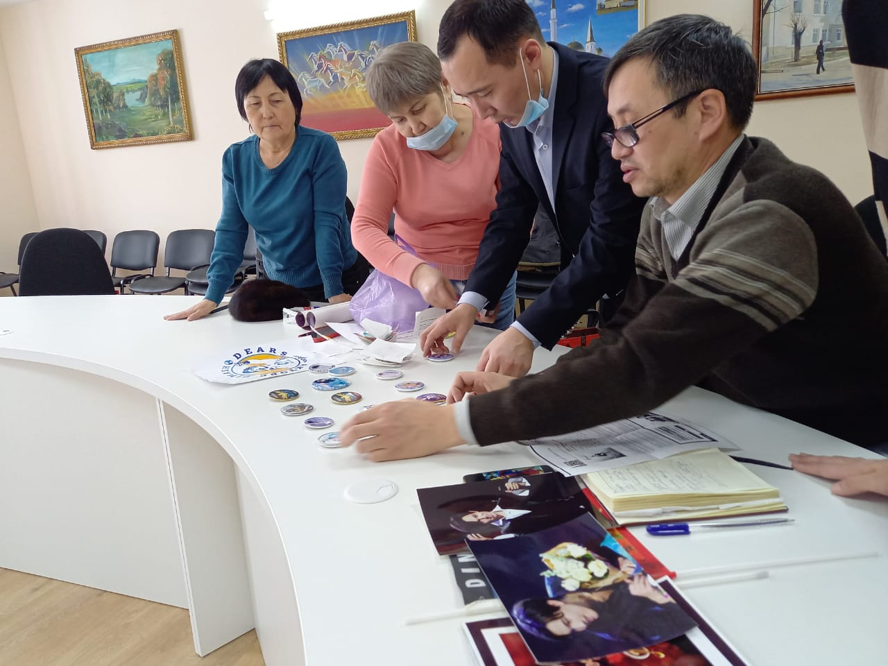 Dears donated items with logos of Dimash's fan-clubs around the world to the Aktobe Museum